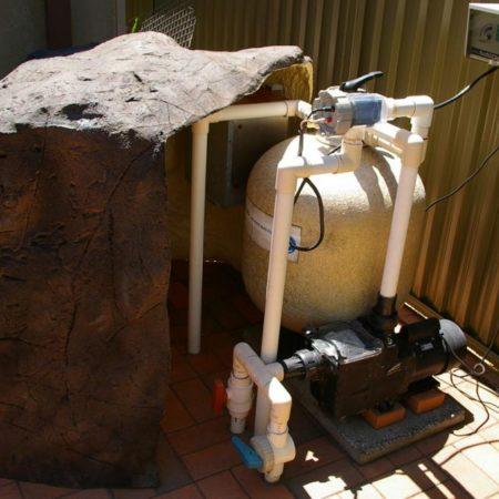 swimming pool pump cover rock